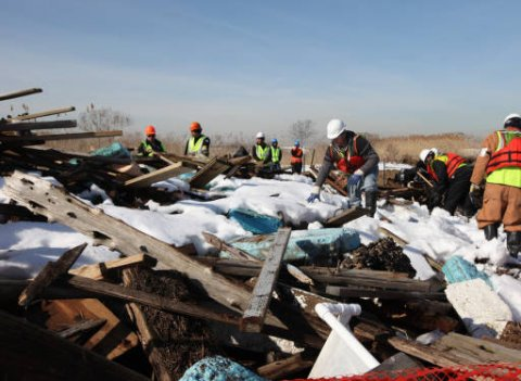 Workers clean up debris from Hurricane Sandy on Lido Beach, NY. Credit: Margie Brenner, US Fish and Wildlife Service.
